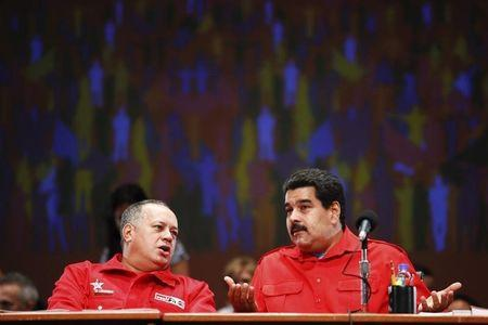 Venezuela's President Nicolas Maduro talks to National Assembly President Diosdado Cabello during a meeting with members of the United Socialist party in Caracas