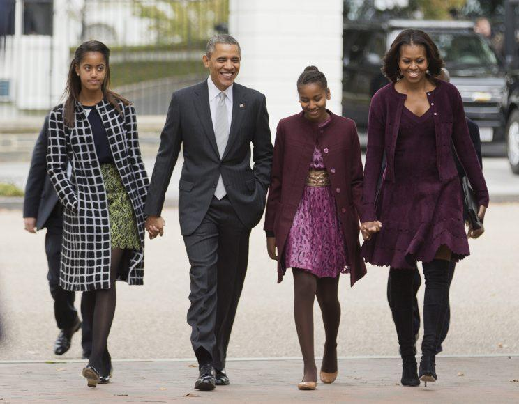 President Barack Obama, second from left, with first lady Michelle Obama, right, and their daughters Malia, left, and Sasha, walk from the White House in Washington to attend a church service on Oct. 27, 2013. (Photo: Manuel Balce Ceneta/AP)