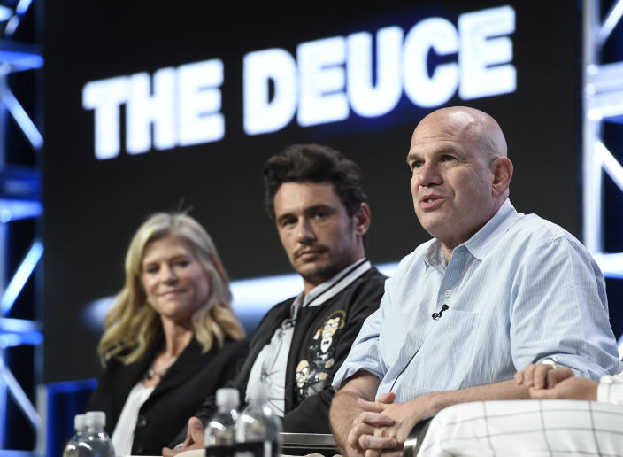"""Director Michelle MacLaren, from left, actor/executive producer James Franco and executive producer David Simon participate in """"The Deuce"""" panel during the HBO Television Critics Association Summer Press Tour at the Beverly Hilton on Wednesday, July 26, 2017, in Beverly Hills, Calif. (Photo by Chris Pizzello/Invision/AP)"""