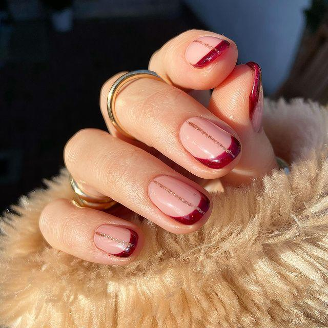 """<p>This intricate design is so simple, yet so beautiful with the combination of rose gold, pink and burgundy. </p><p><a href=""""https://www.instagram.com/p/CIQixnPDhwp/"""" rel=""""nofollow noopener"""" target=""""_blank"""" data-ylk=""""slk:See the original post on Instagram"""" class=""""link rapid-noclick-resp"""">See the original post on Instagram</a></p>"""