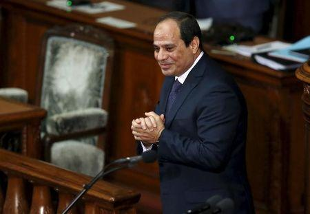 Egypt's President Abdel Fattah al-Sisi reacts after delivering a speech at the Lower House of parliament in Tokyo