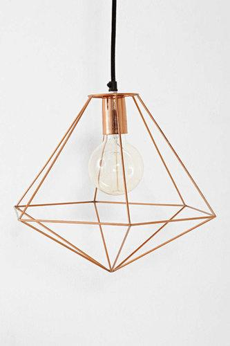 Combine two current decor trends into one with a copper geometric pendant light ($69).