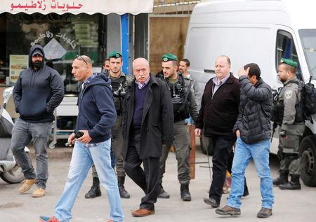 Palestinian geographer Khalil Tafakji, who runs a Palestinian map office, is detained by Israeli security officers as they carry out an Israeli police order to close the office, in Arab East Jerusalem neighbourhood of Beit Hanina
