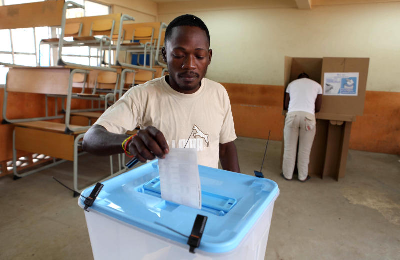 A man casts his ballot at a voting station in Kicolo, Luanda, Angola Friday, Aug. 31, 2012. Victory for the Popular Movement for the Liberation of Angola, (MPLA) would give Angola's ruler for 33 years , President Jose Eduardo dos Santos, another five-year term. (AP Photo/Str)