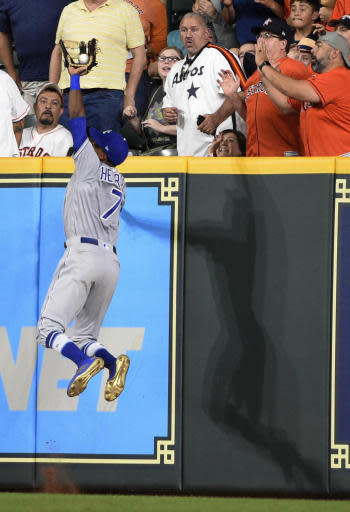 Kansas City Royals right fielder Rosell Herrera catches a fly ball hit by Houston Astros' Alex Bregman during the eighth inning of a baseball game Friday, June 22, 2018, in Houston. (AP Photo/Eric Christian Smith)