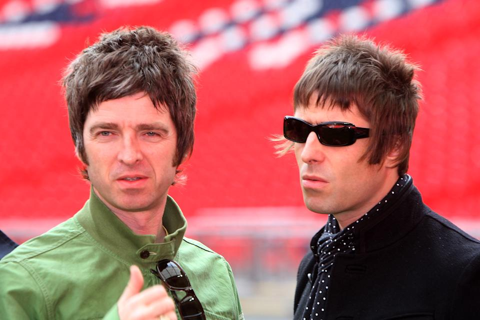 LONDON - OCTOBER 16: L-R Noel and Liam Gallagher attend the Oasis photocall in Wembley Stadium to promote their new album 'Dig out Your Soul' released on October 6, and their two sold out concerts at Wembley Arena, on October 16, 2008 in London, England. (Photo by Dave Hogan/Getty Images)
