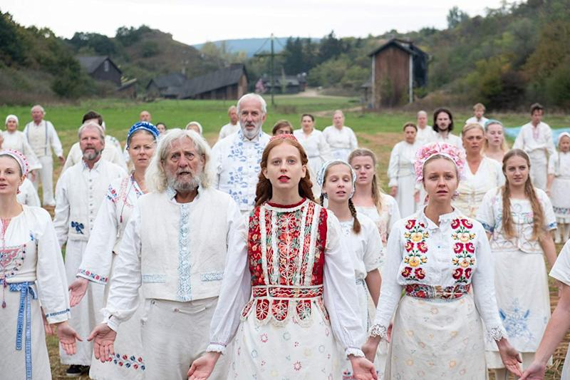 A photo of actors in the film Midsommar.