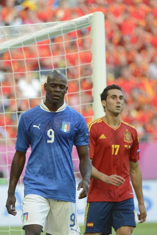 Italian forward Mario Balotelli (L) walks next to Spanish defender Alvaro Arbeloa during the Euro 2012 championships football match Spain vs Italy on June 10, 2012 at the Gdansk Arena. AFP PHOTO / PIERRE-PHILIPPE MARCOUPIERRE-PHILIPPE MARCOU/AFP/GettyImages