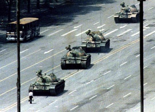A Beijing citizen stands in front of a convoy of tanks on the Avenue of Eternal peace in Tiananmen Square, June 5, 1989.