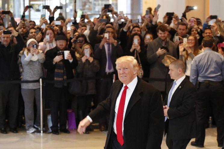 President-elect Donald Trump walks past a crowd as he leaves the New York Times building following a meeting, Tuesday, Nov. 22, 2016, in New York. (Photo: Mark Lennihan/AP)