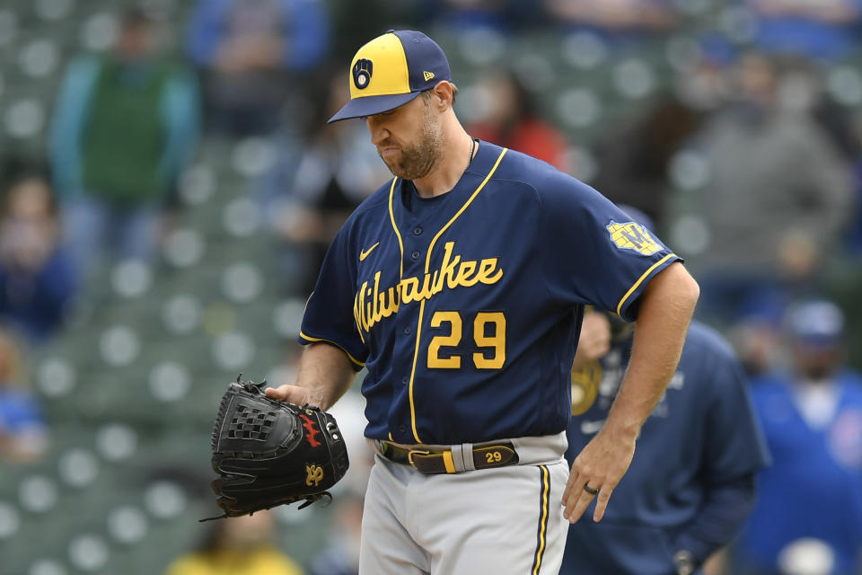Milwaukee Brewers relief pitcher Josh Lindblom (29) reacts after giving up a three-RBI double to Chicago Cubs' Jake Marisnick during the first inning of a baseball game Friday, April 23, 2021, in Chicago. (AP Photo/Paul Beaty)