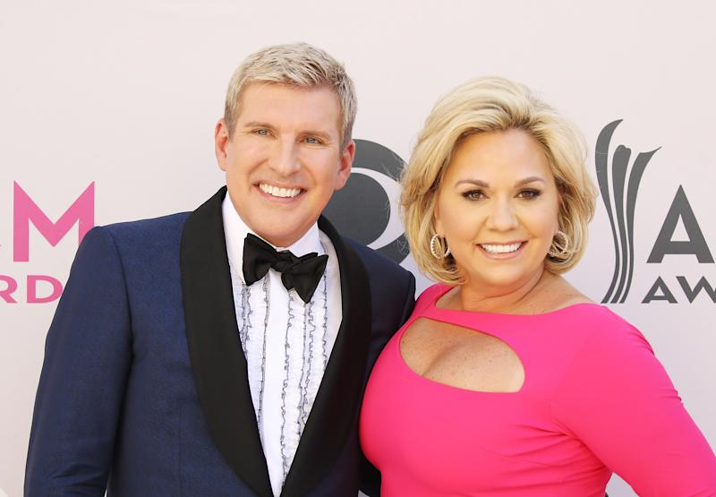 LAS VEGAS, NV - APRIL 02: Todd Chrisley and Julie Chrisley arrive at the 52nd Academy of Country Music Awards held at T-Mobile Arena on April 2, 2017 in Las Vegas, Nevada. (Photo by Michael Tran/FilmMagic)