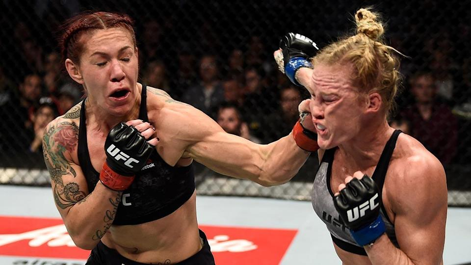 """Cris """"Cyborg"""" Justino (L) got a true test from Holly Holm, but the featherweight champ prevailed in the end. (Getty)"""