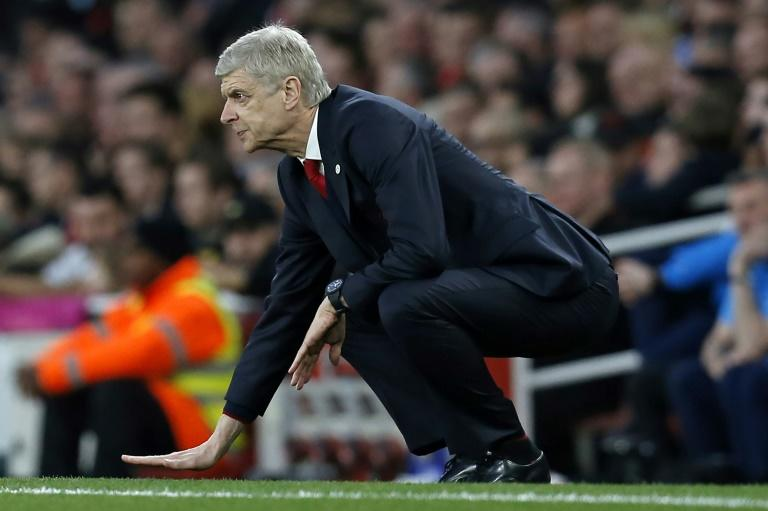 Arsenal's French manager Arsene Wenger gestures on the touchline during their English FA cup quarter final football match against Lincoln City at The Emirates Stadium in London on March 11, 2017