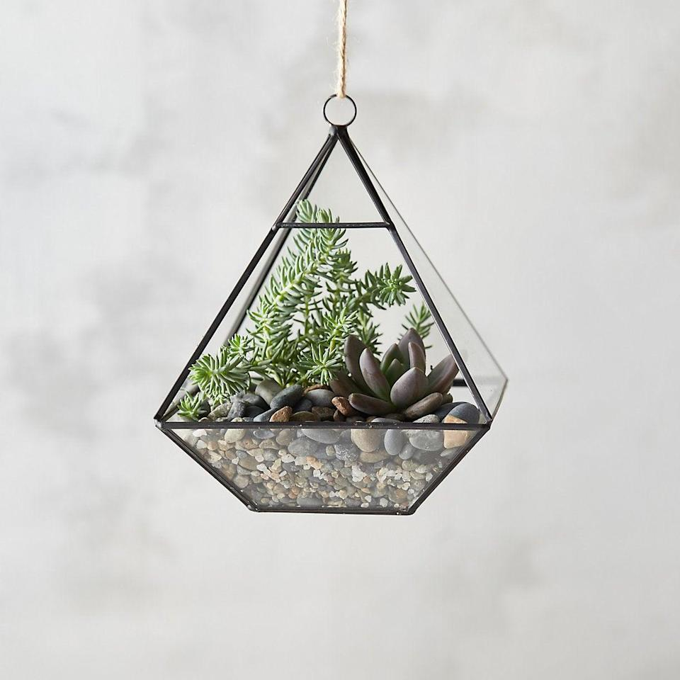 """<h3>Terrain Framed Pyramid Hanging Terrarium</h3><br>""""This terrarium will boost Capricorn's earthy vibes — and desire to create — by giving them the opportunity to connect with nature,"""" Stardust explains. Plus, it'll double as an eyecatching piece of home décor, too.<br><br><strong>Terrain</strong> Framed Pyramid Hanging Terrarium, $, available at <a href=""""https://go.skimresources.com/?id=30283X879131&url=https%3A%2F%2Fwww.shopterrain.com%2Fproducts%2Fframed-pyramid-hanging-terrarium"""" rel=""""nofollow noopener"""" target=""""_blank"""" data-ylk=""""slk:Shop Terrain"""" class=""""link rapid-noclick-resp"""">Shop Terrain</a>"""
