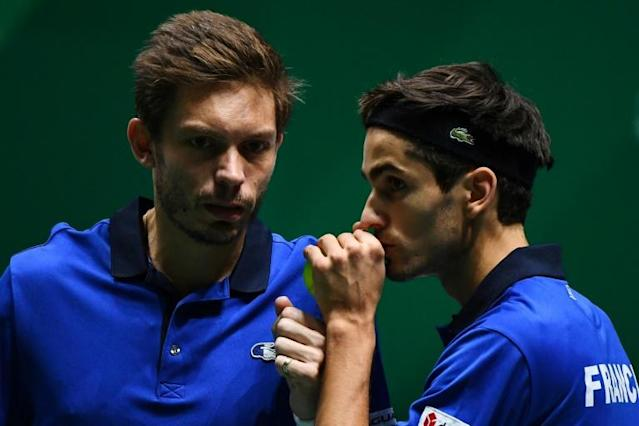France's Nicolas Mahut (left) and Pierre-Hugues Herbert staved off a shock defeat for France by winning their doubles against Ben McLachlan and Yasutaka Uchiyama of Japan in the doubles (AFP Photo/GABRIEL BOUYS )