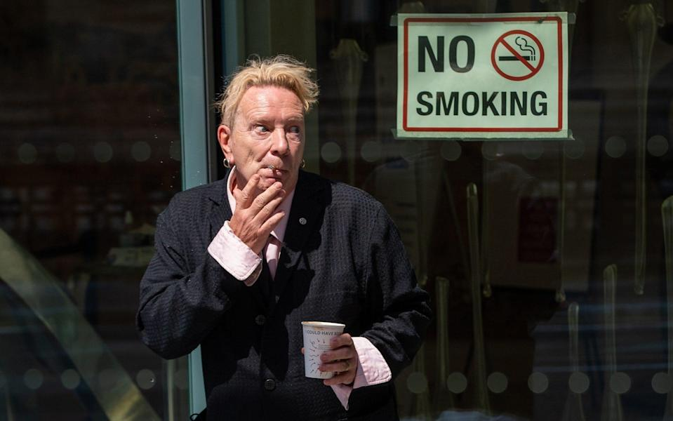 John Lydon, aka Johnny Rotten, smokes outside the Rolls Building at the High Court, London - Dominic Lipinski/PA Wire