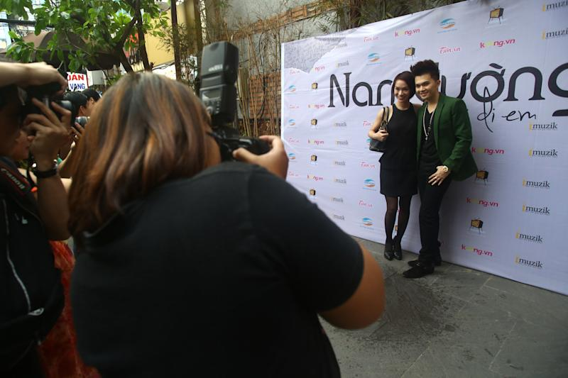 In this photo taken Oct. 10, 2012, Vietnamese singers Nam Cuong, right, and Tra My Idol pose for photographers during a press conference to promote for Nam Cuong's new single. Both of them used to publish and distribute their music through Zing.vn, one of globe's top 550 most visited websites and a wildly popular website laden with unlicensed songs and Hollywood movies, a prime exhibit of the digital piracy that is strangling the music industry in Asia and eroding legitimate online sales around the world. (AP Photo/Na Son Nguyen).