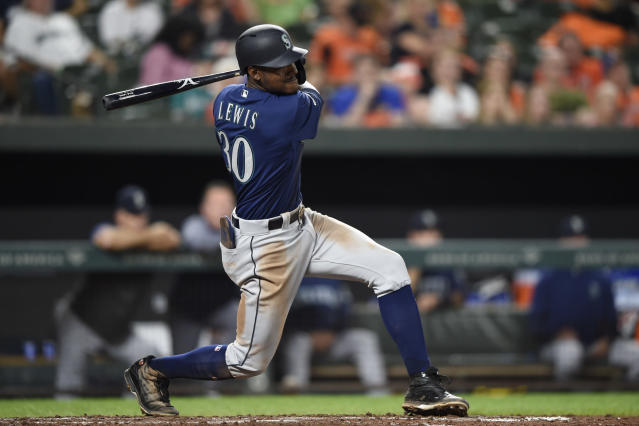 Seattle Mariners Kyle Lewis follows through on a single against the Baltimore Orioles in the fifth inning of a baseball game, Saturday, Sept. 21, 2019, in Baltimore. (AP Photo/Gail Burton)