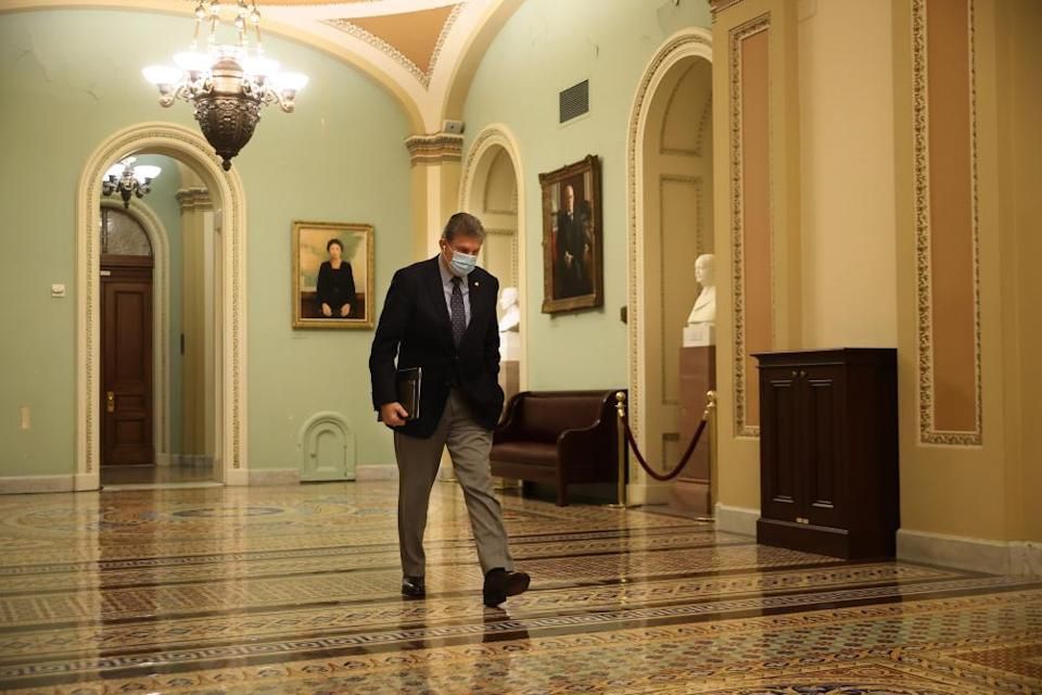 Joe Manchin leaves the Senate chamber last month.
