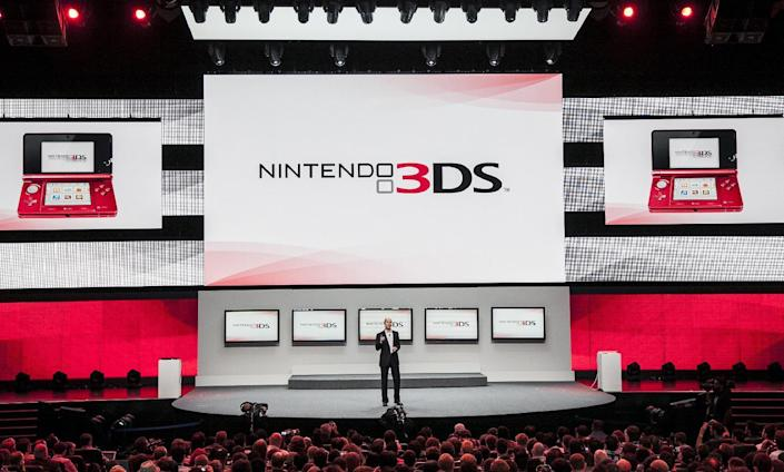 """FILE - In this June 5, 2012 file photo, Scott Moffitt, executive vice president of sales and marketing for Nintendo of America, presents Nintendo 3DS at the Nintendo All-Access presentation at the E3 2012 in Los Angeles. The gaming company said Tuesday, May 6, 2014, it wouldn't bow to pressure to allow players to engage in romantic entanglements with characters of the same sex in the English version of """"Tomodachi Life"""" following a social media campaign launched last month seeking virtual equality for the game's characters, which are modeled after real people. (AP Photo/Damian Dovarganes, file)"""