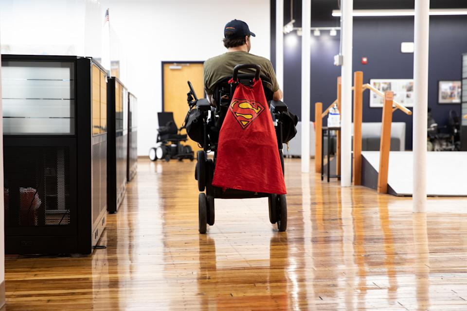 Derek O'Brien, an iBOT personal mobility device user, drives through Mobius Mobility headquarters, on May 4, 2021, in Manchester, New Hampshire. (Kayana Szymczak for Yahoo News)