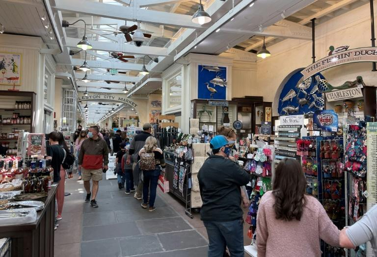 In historic Charleston City Market, South Carolina, and across the US, crowds are returning to businesses and entertainment
