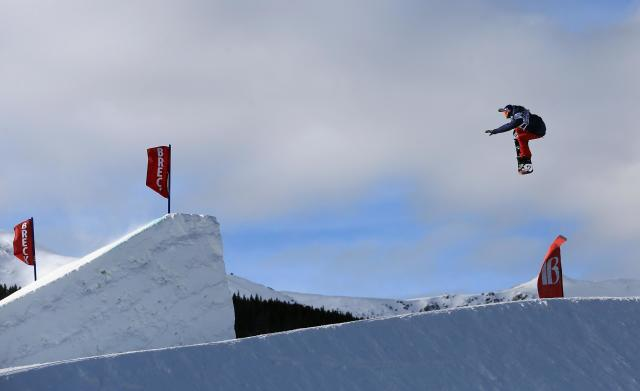 BRECKENRIDGE, CO - DECEMBER 13: (L-R) Enni Rukajarvi of Finland in action as she takes second place in the women's snowboard slopestyle at the Dew Tour iON Mountain Championships on December 13, 2013 in Breckenridge, Colorado. (Photo by Doug Pensinger/Getty Images)