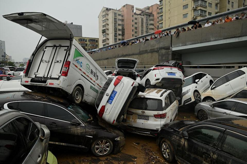 Cars dumped on top of one another after flood waters receded. Source: Getty