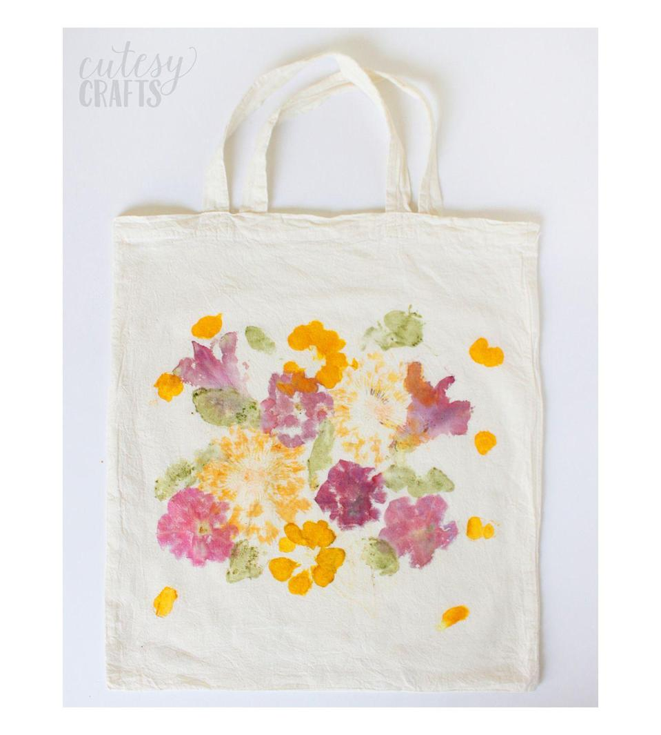 "<p>Grab a few colorful flowers from the garden and get hammering to create this nature-inspired tote. Your artistic efforts will shine through and she'll think it's the best Mother's Day gift ever.</p><p><em><a href=""https://diycandy.com/mothers-day-gift-pounded-flower-tote/"" rel=""nofollow noopener"" target=""_blank"" data-ylk=""slk:Get the tutorial at Cutesy Crafts »"" class=""link rapid-noclick-resp"">Get the tutorial at Cutesy Crafts »</a></em> </p>"