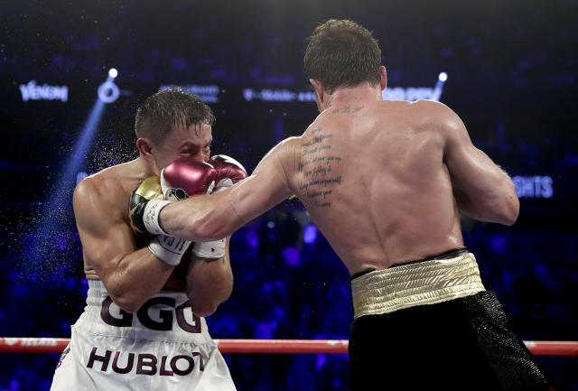 Canelo Alvarez, right, lands a punch against Gennady Golovkin in the eighth round during a middleweight title boxing match, Saturday, Sept. 15, 2018, in Las Vegas. (AP Photo/Isaac Brekken)
