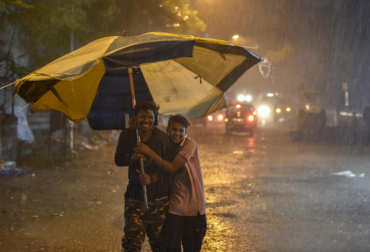 <p>People carry unbrellas as they walk through heavy rain showers at Sion in Mumbai, India. Pre-monsoon showers lashed Mumbai, causing difficulties for residents as the city reported waterlogging, fallen trees and disruptions in flights and road transport. Weather experts have issued weather forecast for this week, warning of a worse spell since July 26, 2005, the day that witnessed severe storm and subsequent deluge. (Kunal Patil/Hindustan Times via Getty Images) </p>