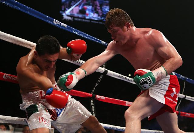 LAS VEGAS, NV - SEPTEMBER 15: (R-L) Canelo Alvarez knocks down Josesito Lopez with a right to the head during their WBC super welterweight title fight at MGM Grand Garden Arena on September 15, 2012 in Las Vegas, Nevada. (Photo by Josh Hedges/Getty Images)