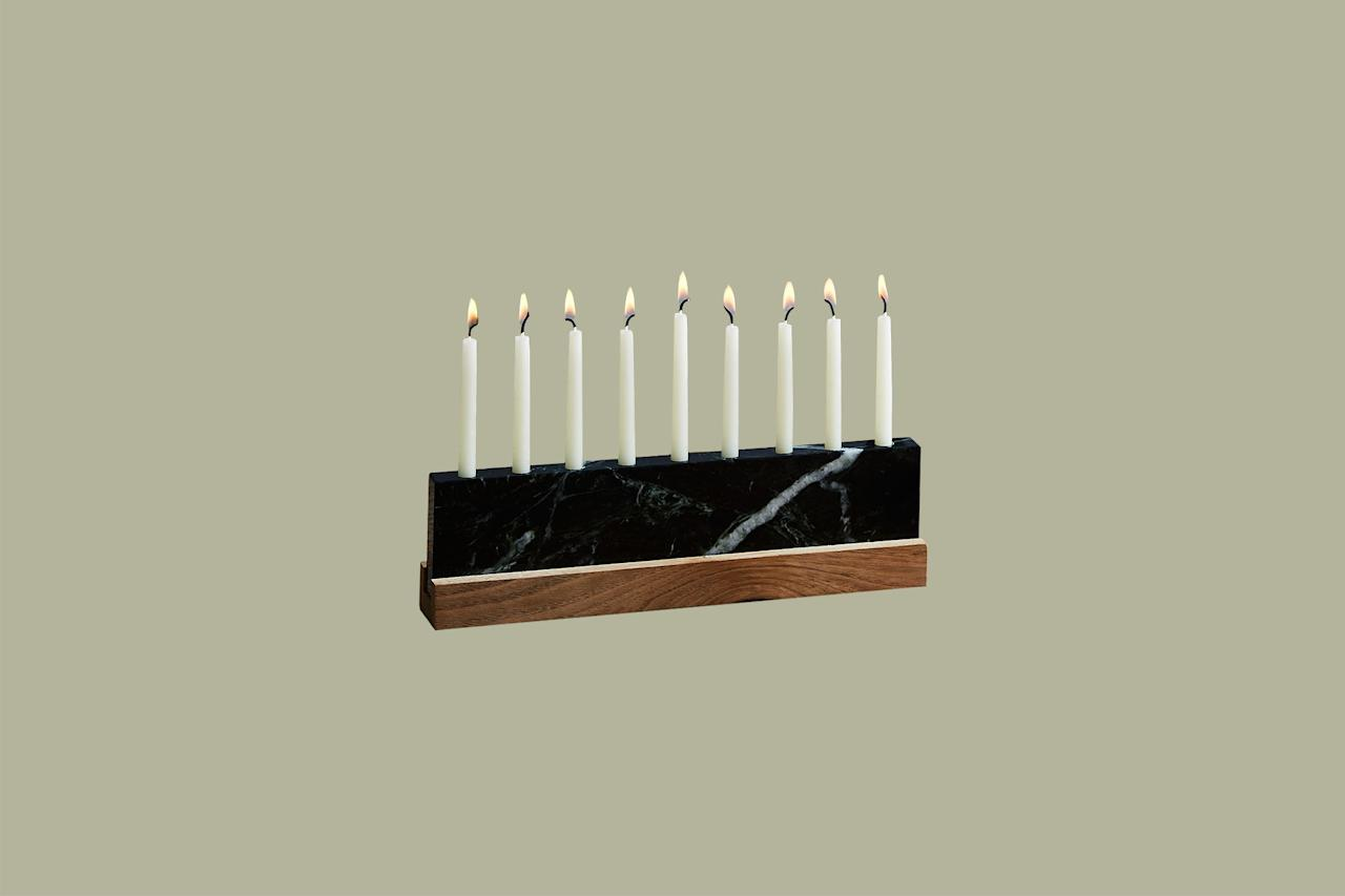 "<p>Nothing looks more stately at the table than this menorah made from a slab of veined Vermont green marble and silky walnut. JK Adams is well known for their charming home goods, and this handcrafted piece from the family-owned business in Vermont is designed with a sliding wood base to secure nine standard menorah candles.</p><p><em>JK Adams Vermont Green Marble &amp; Walnut Menorah, $68, </em><a href=""http://www.anrdoezrs.net/links/9104911/type/dlg/sid/MMSLHOLModernMenorahsCBiggsOct19/https://food52.com/shop/products/5293-vermont-green-marble-walnut-menorah""><em>food52.com</em></a><em>.</em></p>"