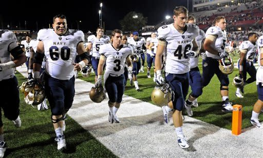 Navy players leave the field after an NCAA college football game against Troy in Troy, Ala., Saturday, Nov. 10, 2012. Troy won 41-31. (AP Photo/The (Troy)