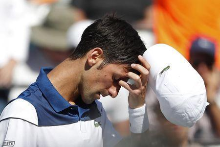 Mar 23, 2018; Key Biscayne, FL, USA; Novak Djokovic of Serbia reacts after losing a game against Benoit Paire of France (not pictured) on day four of the Miami Open at Tennis Center at Crandon Park. Paire won 6-3, 6-4. Mandatory Credit: Geoff Burke-USA TODAY Sports
