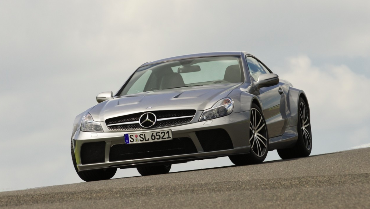 """<p>AMG went all-out on the SL back in 2009 with the introduction of <a rel=""""nofollow"""" href=""""http://www.roadandtrack.com/new-cars/reviews/a14493/2009-mercedes-benz-sl65-amg-black-series-2/"""">the Black Series</a>. The hard-top convertible roof was replaced with a fix carbon fiber piece, and the twin-turbo V12 pushed out 661 horsepower and a monstrous 738 lb-ft of torque. The only downside was the car's slow-shifting five-speed auto. </p>"""