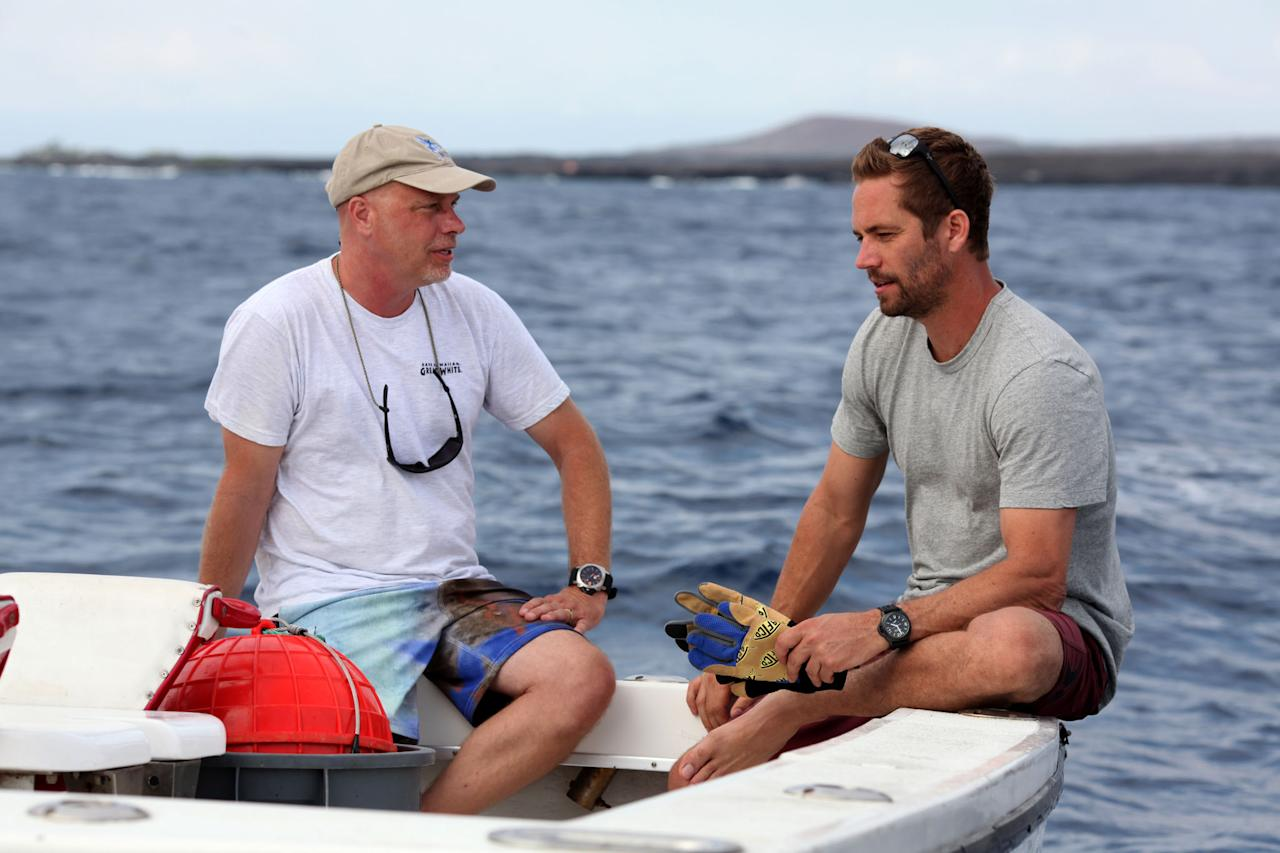 Michael Domeier and Paul Walker talk about catching and tagging techniques while waiting for a bite off the coast of Hawaii.