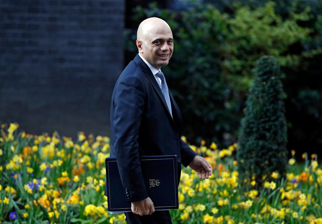 Britain's Home Secretary Sajid Javid smiles as he leaves 10 Downing Street in London after a cabinet meeting, Tuesday, April 2, 2019. Political chaos continued to reign as the Cabinet held a marathon session to try to find a way out of the crisis. A group of pro-Brexit ministers pressed British Prime Minister Theresa May to go forward with a no-deal departure. Other Cabinet members and a majority of lawmakers think that would be a disaster. (AP Photo/Alastair Grant)