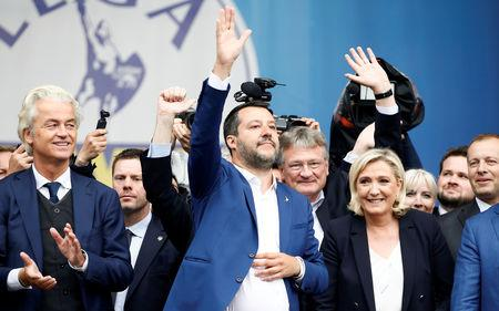 FILE PHOTO: Geert Wilders, leader of Dutch party PVV (Party for Freedom), Italy's Deputy Prime Minister Matteo Salvini, Marine Le Pen, leader of French National Rally party attend a major rally of European nationalist and far-right parties ahead of EU parliamentary elections in Milan, Italy May 18, 2019. REUTERS/Alessandro Garofalo/File Photo