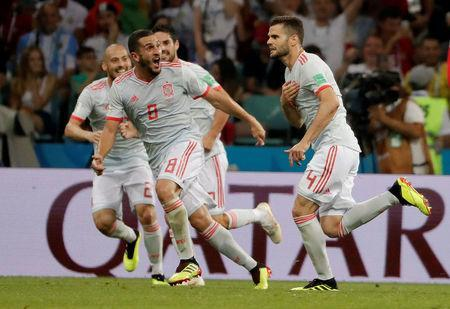 Soccer Football - World Cup - Group B - Portugal vs Spain - Fisht Stadium, Sochi, Russia - June 15, 2018 Spain's Nacho celebrates with team mates after scoring their third goal REUTERS/Carlos Barria