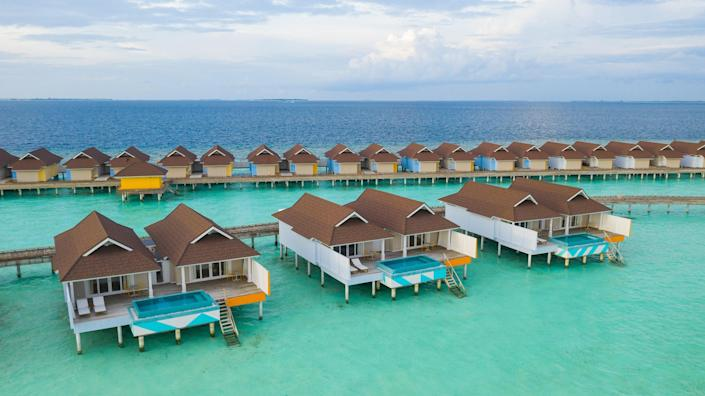 """Located in the Indian Ocean, the small archipelago that makes up the Republic of Maldives has ideal conditions for a work/life balance. For $5,000 per month, and a 25% discount on food and beverages, stay at <a href=""""https://www.standardhotels.com/maldives/properties/huruvalhi"""" rel=""""nofollow noopener"""" target=""""_blank"""" data-ylk=""""slk:the Standard,"""" class=""""link rapid-noclick-resp"""">the Standard,</a> the only hotel on the island (it's 30 minutes by seaplane from Velana International Airport) and the perfect spot for some much-needed recharging. Maldives is open to visitors from all countries, as long as they obtain a negative COVID-19 test within 96 hours of departure from their original destination. No quarantine necessary. At the 115-villa resort, every accommodation comes with a private terrace and plunge pool, the perfect backdrop for your Zoom calls."""