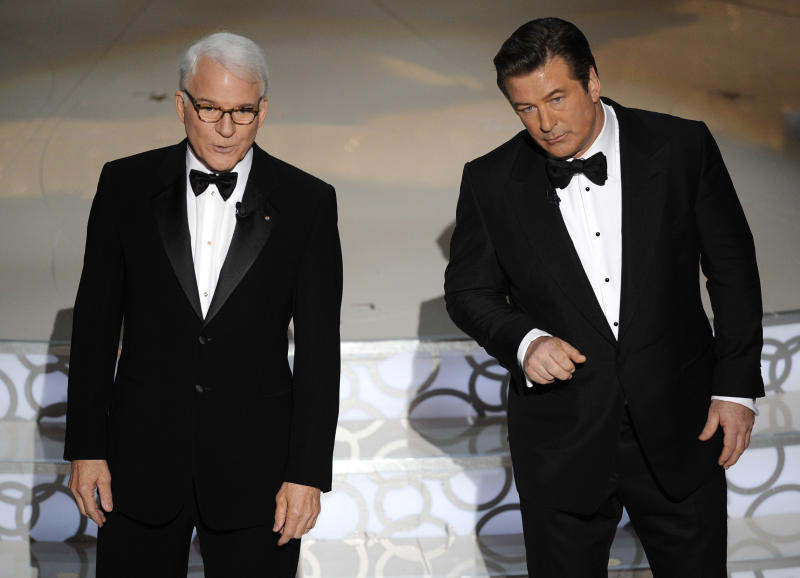 FILE - In this March 7, 2010 file photo, hosts Alec Baldwin, right, and Steve Martin are seen on stage at the 82nd Academy Awards, in the Hollywood section of Los Angeles. The Board of Governors of the Academy of Motion Picture Arts and Sciences will present Honorary Awards to Martin, Angela Lansbury, and Piero Tosi, and the Jean Hersholt Humanitarian Award to Angelina Jolie. All four awards will be presented at the Academy's 5th Annual Governors Awards on Saturday, November 16, 2013, at the Ray Dolby Ballroom at the Hollywood & Highland Center in the Hollywood section of Los Angeles. (AP Photo/Mark J. Terrill, File)