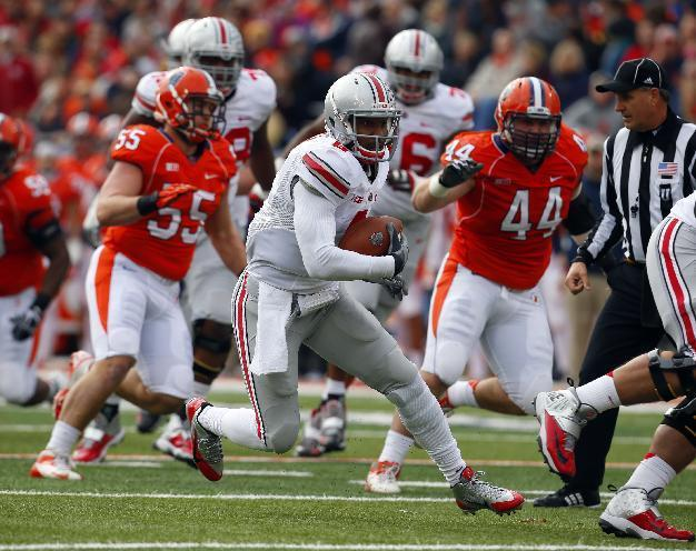 Ohio State quarterback Braxton Miller, center, is chased by Illinois defensive lineman Austin Teitsma (44) and defensive lineman Houston Bates (55) during the first half of an NCAA college football game on Saturday, Nov. 16, 2013, in Champaign, Ill. (AP Photo/Jeff Haynes)