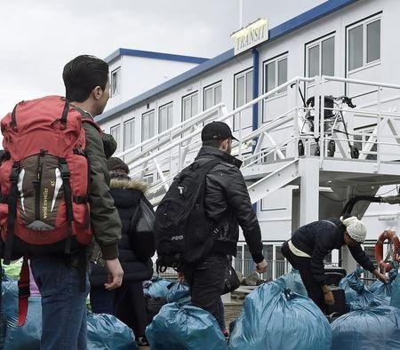 Refugees arrive at the Dutch-owned houseboat 'Transit' in the harbour of Hamburg