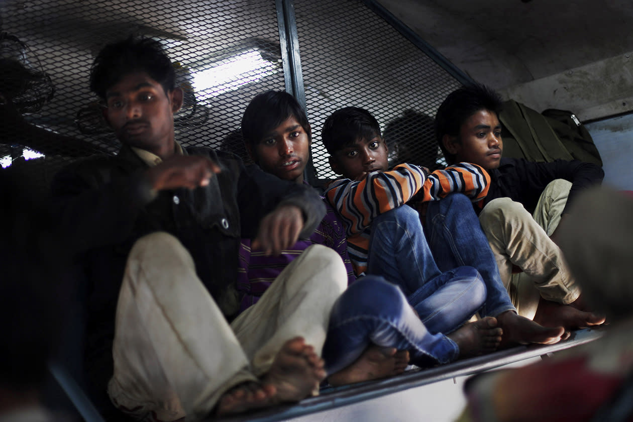 Indian passengers settle inside an overcrowded train in New Delhi, India.