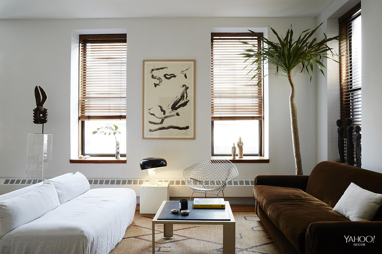 <p>The sitting area is as much a space to relax as it is a place to showcase the couples' most-cherished design and art pieces including a Snoopy table lamp (center) designed by Achille Castiglioni and Pier Giacomo in the '60s.<br /></p>