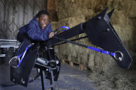 Shaddai Mcleod, 9, rides on a training horse at Ebony Horse Club in Brixton, south London, Sunday, April 18, 2021. In the midst of south London's hustle and bustle, only a 10-minute walk from a subway station, is a school where children are encouraged to horse around. The Ebony Horse Club provides 140 rides per week to children in the local community offering them the opportunity to learn important life skills along with horseback riding. (AP Photo/Kirsty Wigglesworth)