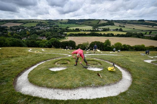 Volunteers refreshed the Giant's chalk (Ben Birchall/PA).