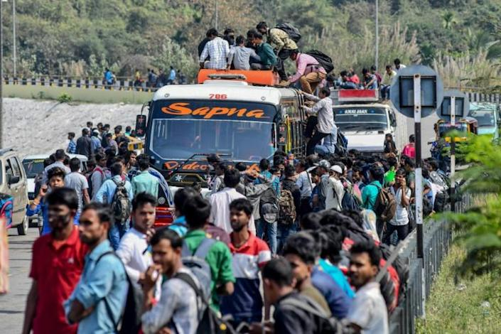Indians clambering to get home in Guwahati, Assam state on March 24 before a government-imposed lockdown (AFP Photo/Biju BORO)